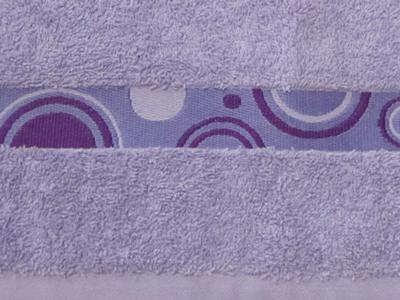 Indvævet-symbol-bort-håndklæder-uniquemade