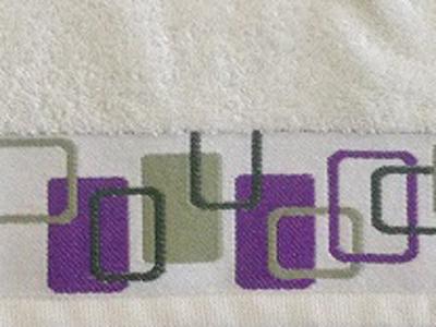 Indvævet-bort-logo i håndklæder-indvævet-uniquemade