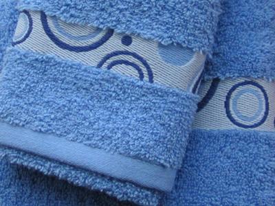Håndklæder-med-indvævet-logo-i-borten-uniquemade