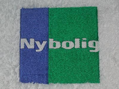 Håndklæder-med-Nybolig_broderi-uniquemade