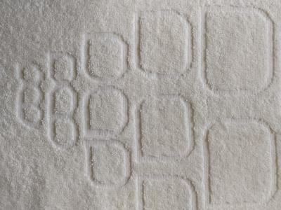 Håndklæder-med-reliefvævet-logo-uniquemade